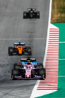 Lance Stroll, Racing Point RP19, leads Daniel Ricciardo, Renault F1 Team R.S.19, and Carlos Sainz Jr., McLaren MCL34