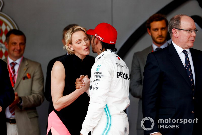 Lewis Hamilton, Mercedes AMG F1, 1st position, is greeted on the podium by Princess Charlene of Monaco