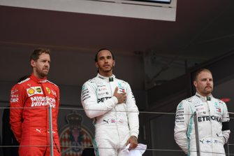 Sebastian Vettel, Ferrari, 2nd position, Lewis Hamilton, Mercedes AMG F1, 1st position, and Valtteri Bottas, Mercedes AMG F1, 3rd position, on the podium