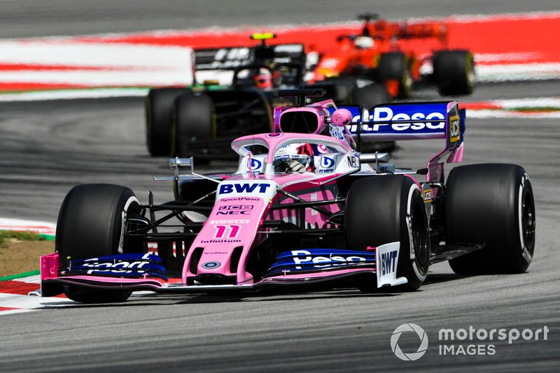 Sergio Perez, Racing Point RP19, leads Kevin Magnussen, Haas F1 Team VF-19, and Sebastian Vettel, Ferrari SF90