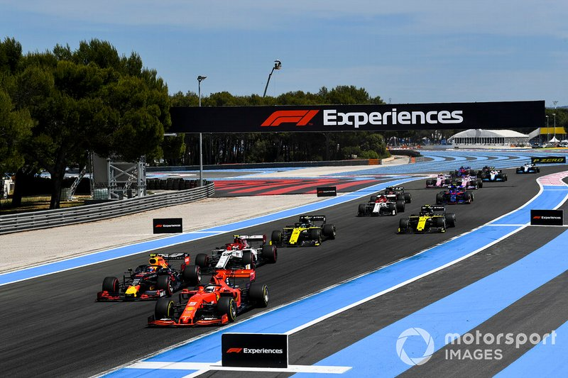 Sebastian Vettel, Ferrari SF90, leads Pierre Gasly, Red Bull Racing RB15, Antonio Giovinazzi, Alfa Romeo Racing C38, Daniel Ricciardo, Renault F1 Team R.S.19, Nico Hulkenberg, Renault F1 Team R.S. 19, and the remainder of the field on the opening lap