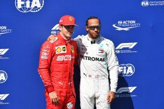Charles Leclerc, Ferrari, and pole man Lewis Hamilton, Mercedes AMG F1