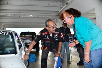 Herbert Gomez gets the final sign of approval on the car's original 1988 SCCA Runoff's tech-inspection stickers.
