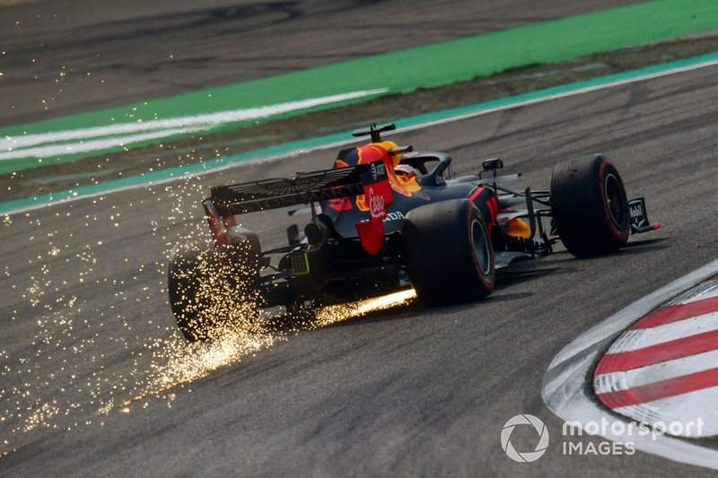 Sparks kick up from the rear of Max Verstappen, Red Bull Racing RB15
