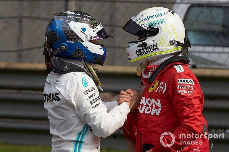 Sebastian Vettel, Ferrari, congratulates pole man Valtteri Bottas, Mercedes AMG F1