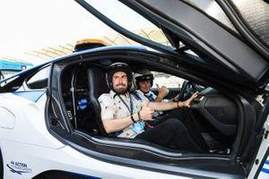 Alex Fernandez, comedian, on a hot laps with Alejandro Agag, CEO, Formula E