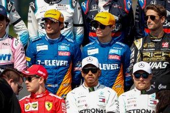 Carlos Sainz Jr., McLaren, Lando Norris, McLaren, and Romain Grosjean, Haas F1 stand behind Sebastian Vettel, Ferrari, Lewis Hamilton, Mercedes AMG F1, and Valtteri Bottas, Mercedes AMG F1