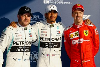 Valtteri Bottas, Mercedes AMG F1, Pole Sitter Lewis Hamilton, Mercedes AMG F1 and Sebastian Vettel, Ferrari in Parc Ferme