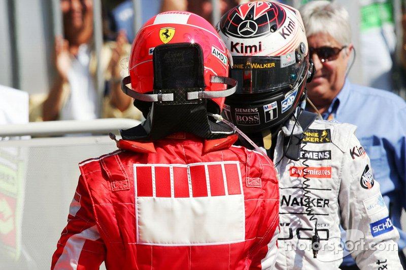 Michael Schumacher, Ferrari e Kimi Raikkonen, McLaren, nel parco chiuso