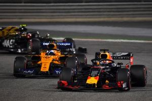 Max Verstappen, Red Bull Racing RB15, leads Carlos Sainz Jr., McLaren MCL34, and Kevin Magnussen, Haas F1 Team VF-19
