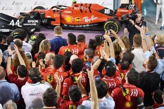 Ferrari team personnel gather at the podium