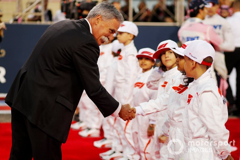 Chase Carey, Chairman, Formula 1, meets the Grid Kid mascots