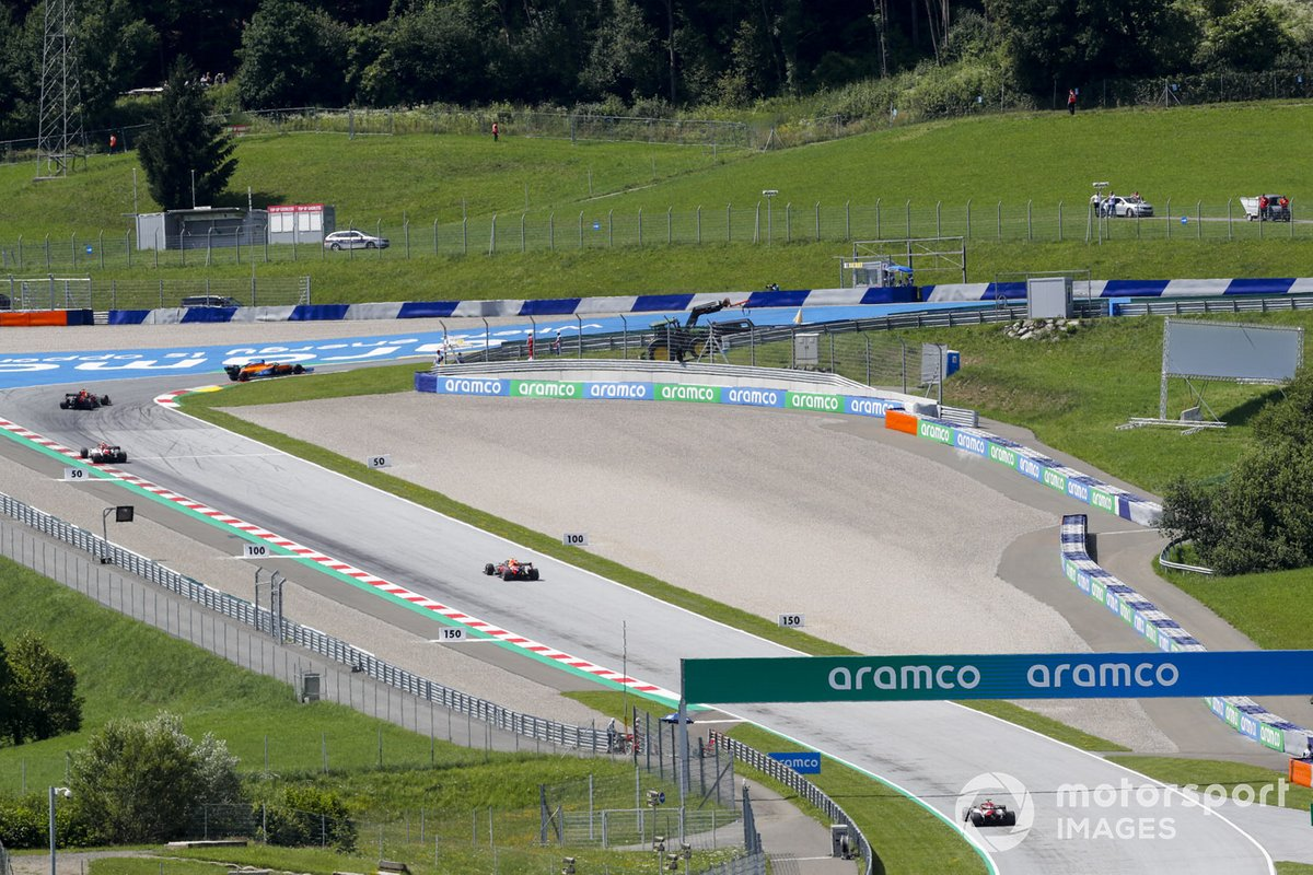 Carlos Sainz Jr., McLaren MCL35, leads Max Verstappen, Red Bull Racing RB16, Antonio Giovinazzi, Alfa Romeo Racing C39, Alex Albon, Red Bull Racing RB16, and Kimi Raikkonen, Alfa Romeo Racing C39
