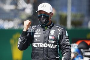 Valtteri Bottas, Mercedes F1 W11 EQ Performance, celebrates after taking Pole Position