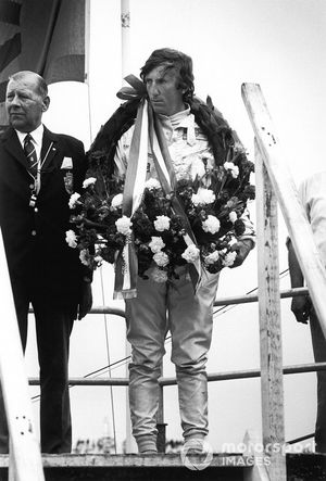 Podium: race winner Jochen Rindt, Lotus 72C-Ford, upset on the podium due to the death of Piers Courage