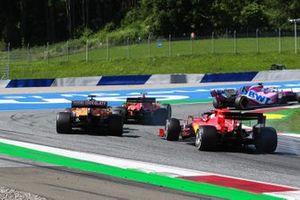 Charles Leclerc, Ferrari SF1000, leads Carlos Sainz Jr., McLaren MCL35, and Sebastian Vettel, Ferrari SF1000