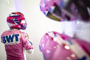 Sergio Perez, Racing Point, puts on his helmet in the garage