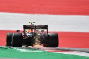 Sparks kick up from the car of Alex Albon, Red Bull Racing RB16