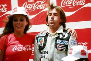 Race winner Jacques Laffite, Ligier takes a deep breath on the podium as he is aided by a Coca-Cola girl