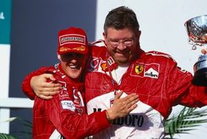 Michael Schumacher and Ross Brawn celebrate the win