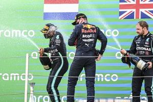 Lewis Hamilton, Mercedes-AMG Petronas F1, 1st position, Max Verstappen, Red Bull Racing, 2nd position, and Valtteri Bottas, Mercedes-AMG Petronas F1, 3rd position, on the podium