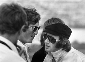 Jochen Rindt, Lotus 72-Ford, talks to Jackie Stewart, March 701-Ford