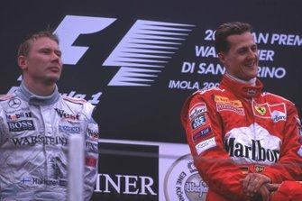 Podium: Race winner Michael Schumacher, Ferrari, second place Mika Hakkinen, McLaren