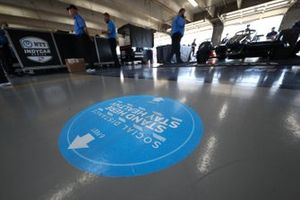 A social distancing decal on tech garage floor