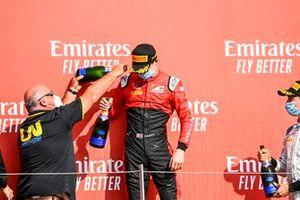 Callum Ilott, UNI-Virtuosi, celebrates victory on the podium
