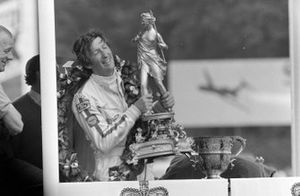 Race winner Jochen Rindt with his trophy on the podium