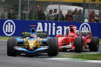 Fernando Alonso, Renault R25, leads Michael Schumacher, Ferrari F2005