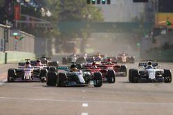 Lewis Hamilton, Mercedes AMG F1 W08, Sebastian Vettel, Ferrari SF70H, Sergio Perez, Sahara Force India F1 VJM10, Felipe Massa, Williams FW40, at the restart