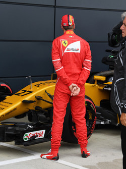 Sebastian Vettel, Ferrari celebrates in parc ferme and observes the Renault Sport F1 Team RS17