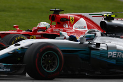 Sebastian Vettel, Ferrari SF70H, passes Valtteri Bottas, Mercedes AMG F1 W08