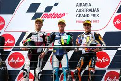 Podium: second place Anthony West, Race winner Pol Espargaro, third place Marc Marquez