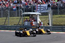 Nico Hulkenberg, Renault Sport F1 Team RS17 passes Jolyon Palmer, Renault Sport F1 Team RS17