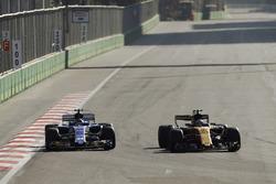 Jolyon Palmer, Renault Sport F1 Team RS17, passes Pascal Wehrlein, Sauber C36-Ferrari