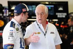 Brad Keselowski, Team Penske Ford, talks with team owner Roger Penske in the garage area