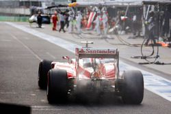 Kimi Raikkonen, Ferrari SF16-H returns to the pits to retire with fire in his exhaust