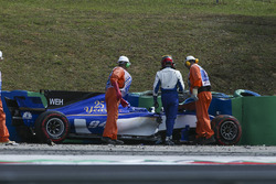 Pascal Wehrlein, Sauber C36-Ferrari, is assisted by marshals after crashing out of FP2
