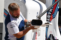 Williams mechanics cleans the pit stop lights