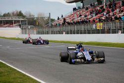 Pascal Wehrlein, Sauber C36, leads Carlos Sainz Jr., Scuderia Toro Rosso STR12 and Romain Grosjean,