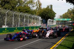 Daniil Kvyat, Scuderia Toro Rosso STR12, leads Sergio Perez, Force India VJM10 and Nico Hulkenberg,