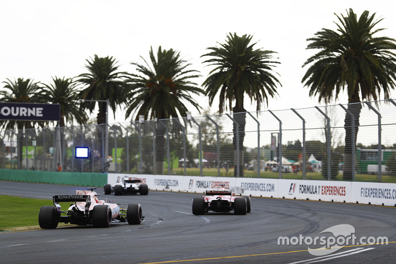 Esteban Ocon, Force India VJM10, follows a Ferrari and a Williams