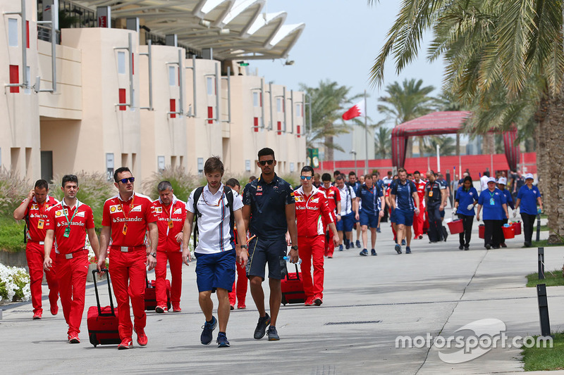 The teams arrive in the paddock