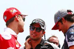 Sebastian Vettel, Ferrari with Sergio Perez, Sahara Force India F1 and Carlos Sainz Jr., Scuderia To