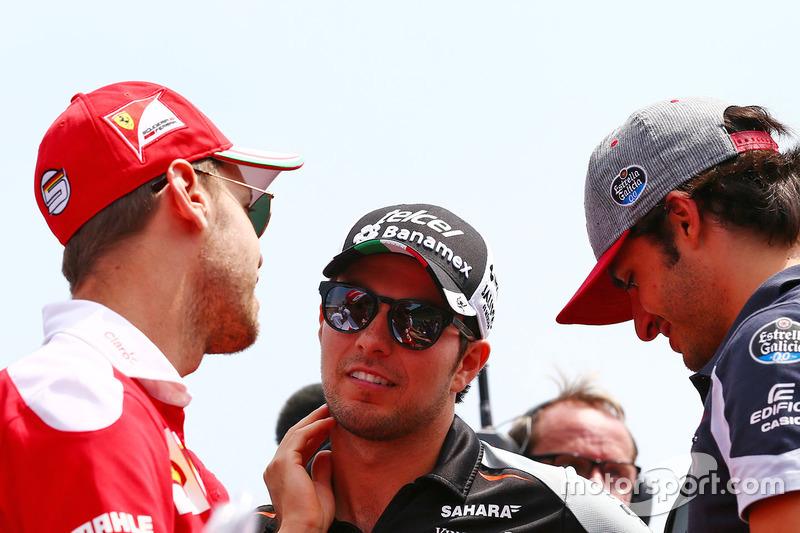Sebastian Vettel, Ferrari with Sergio Perez, Sahara Force India F1 and Carlos Sainz Jr., Scuderia Toro Rosso on the drivers parade