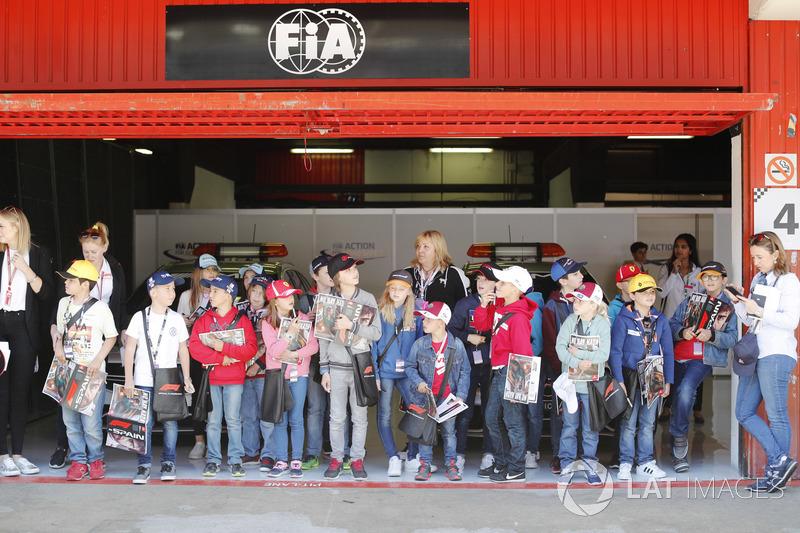 The grid kids in a garage