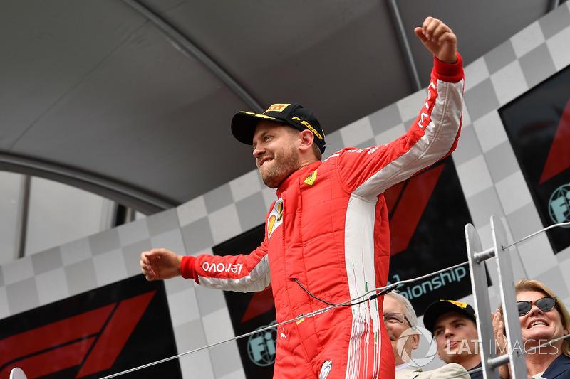 Race winner Sebastian Vettel, Ferrari SF71H celebrates on the podium