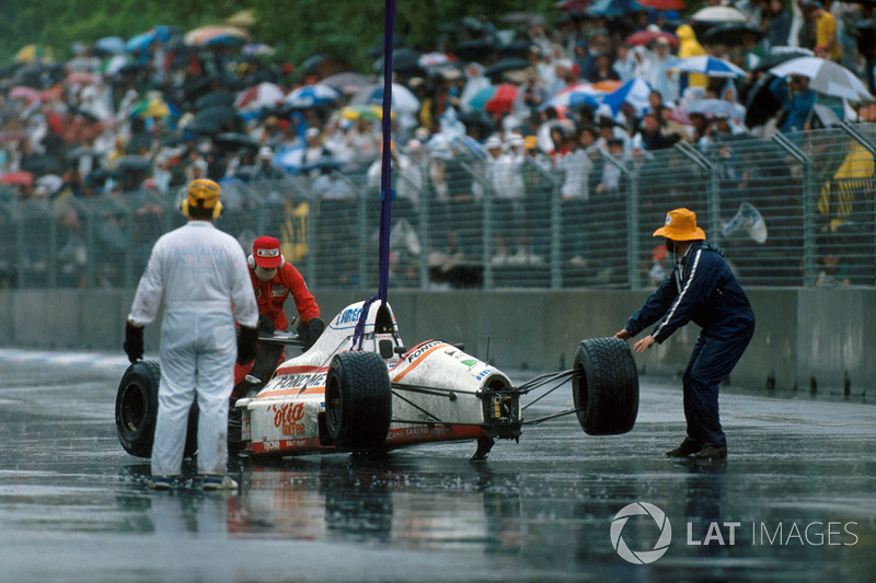 Piercarlo Ghinzani's, Osella FA1-M89 is removed after a shunt with Nelson Piquet,